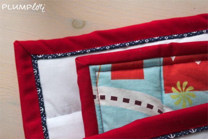 Babyquilt mit Faux-Paspel-Binding